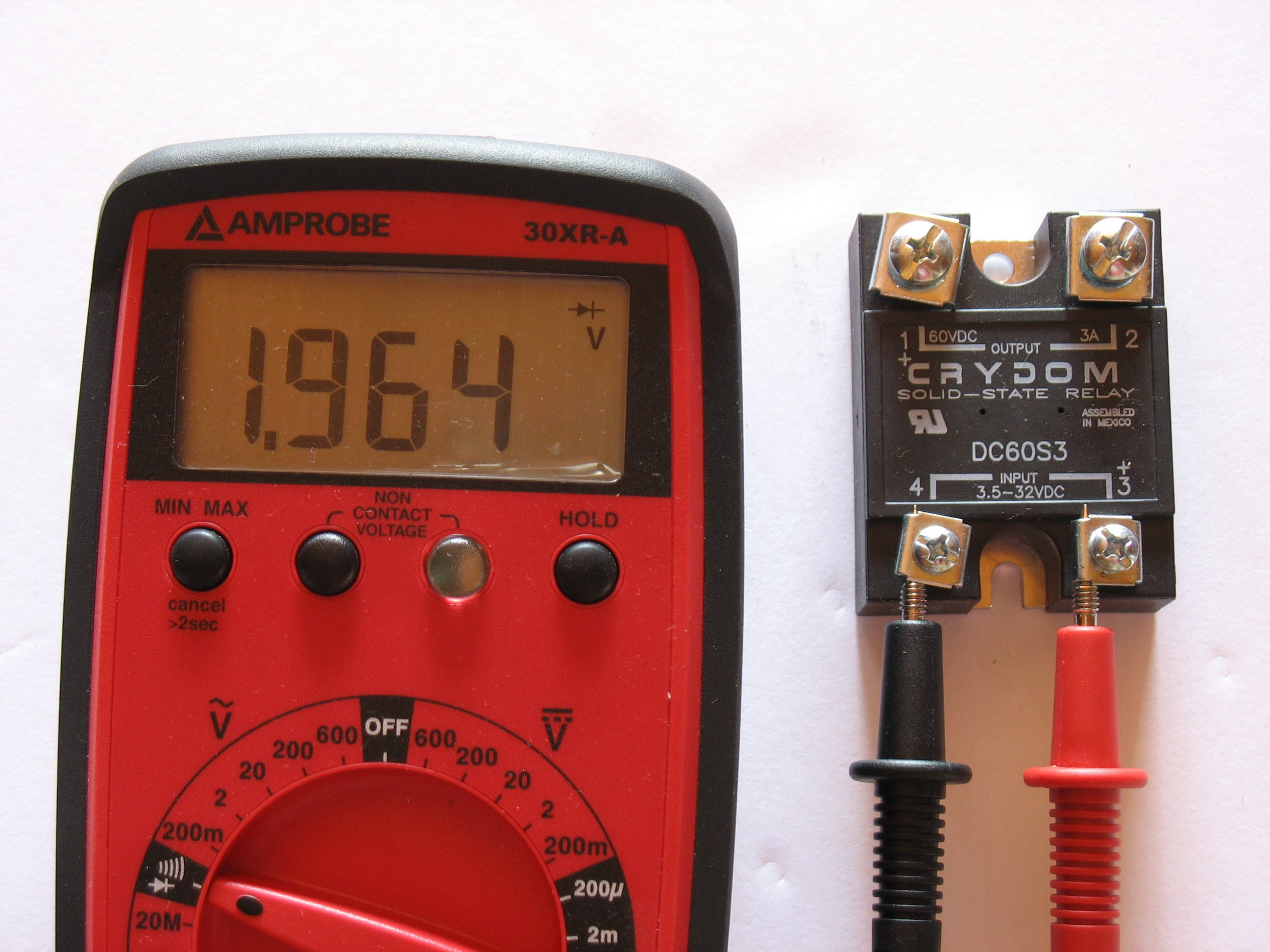using a diode test, the input terminals can be assessed for the operation of the internal LED