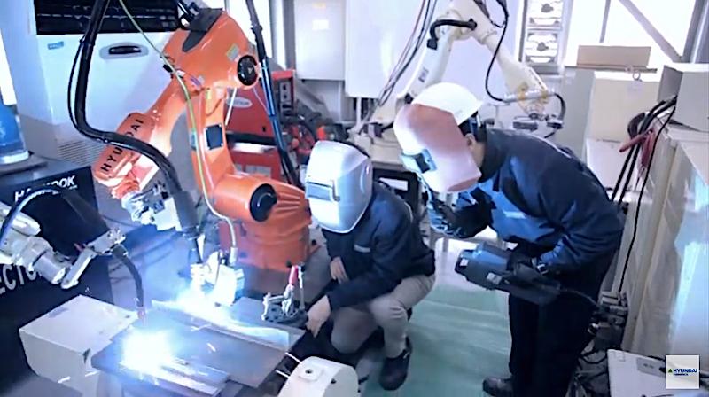 Hyundai Robotics welding robot and staff